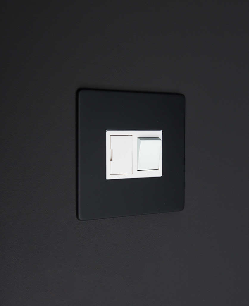 black and white fused spur switch