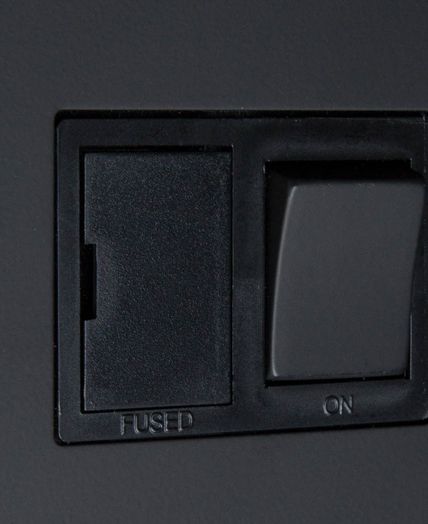 black fused spur switch close up