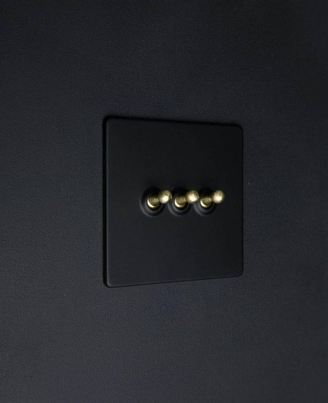 Black & gold triple toggle light switch