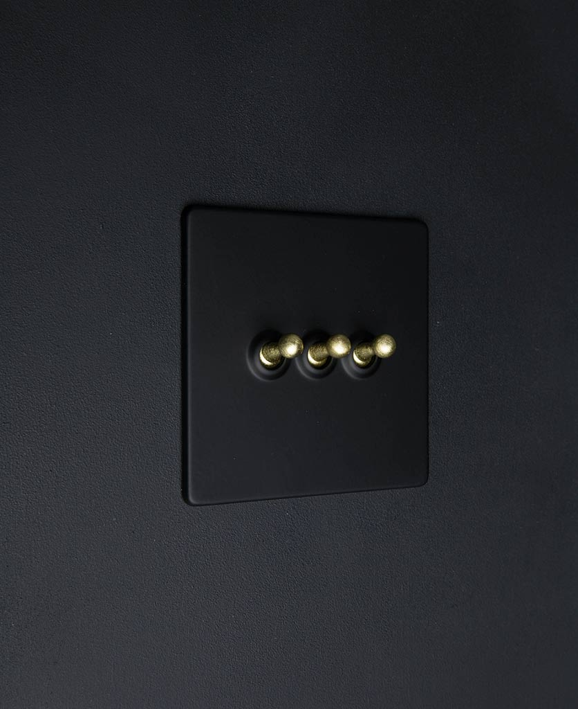 Black & gold triple toggle light switch