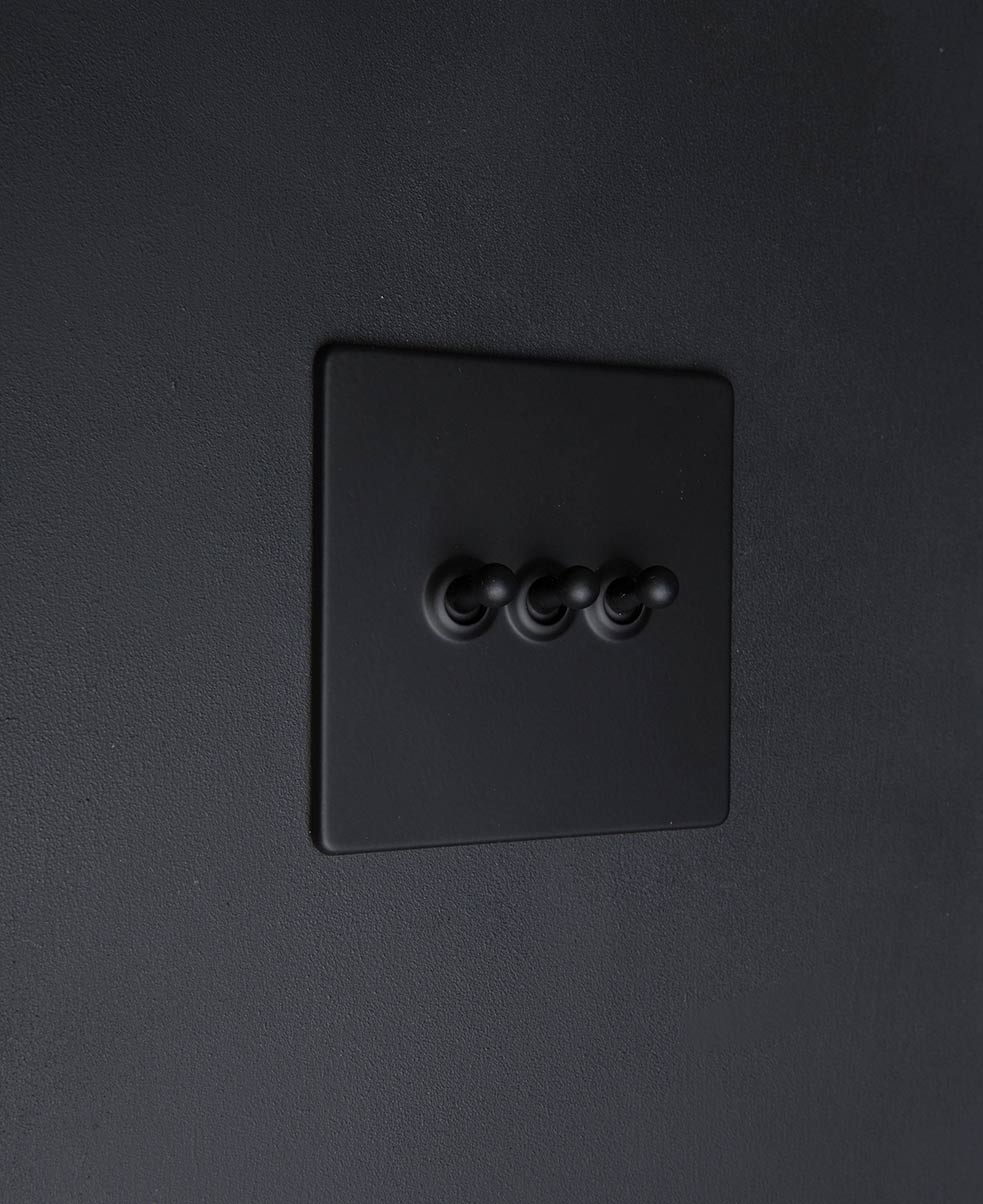 Black 240v toggle switch with black toggle detailing