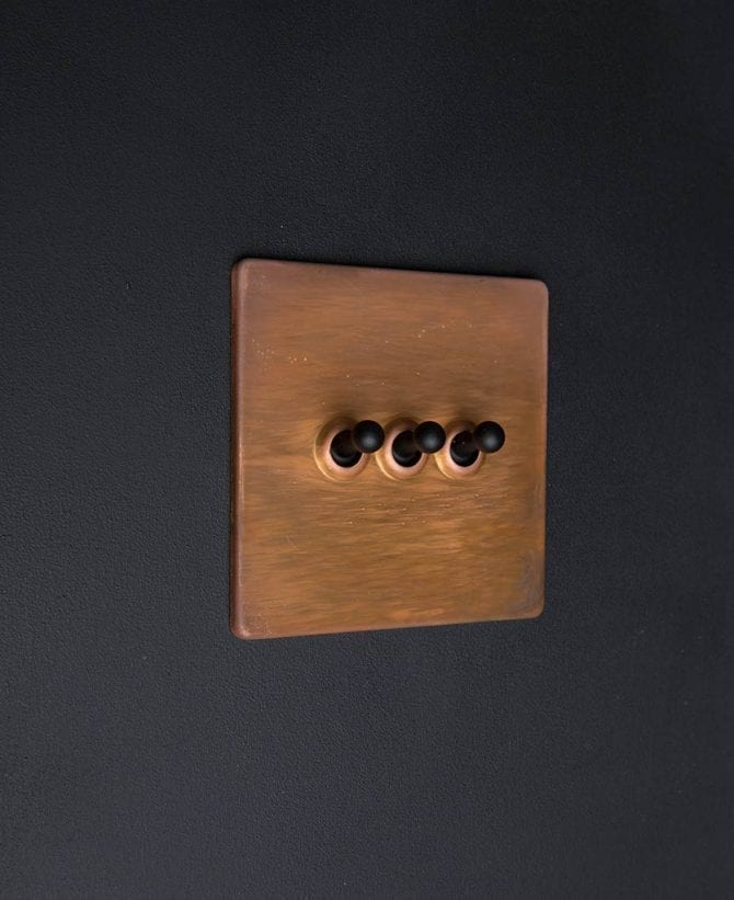 copper & black triple toggle switch