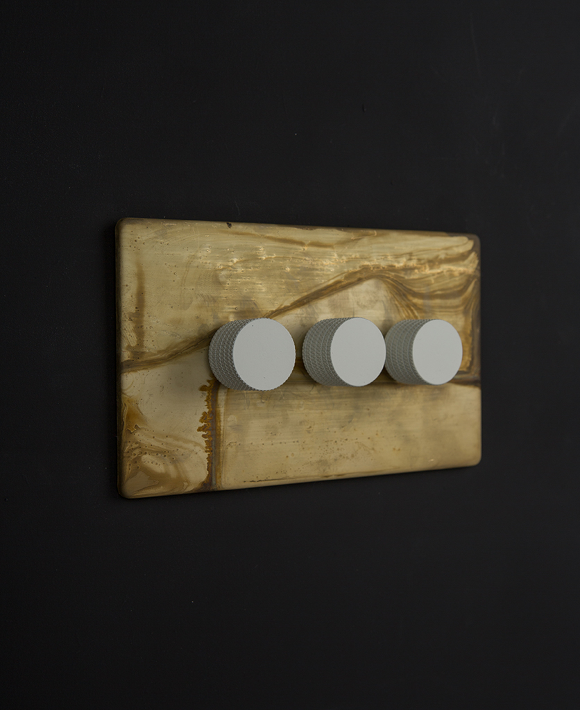 smoked gold dimmer light switch with white dimming knobs