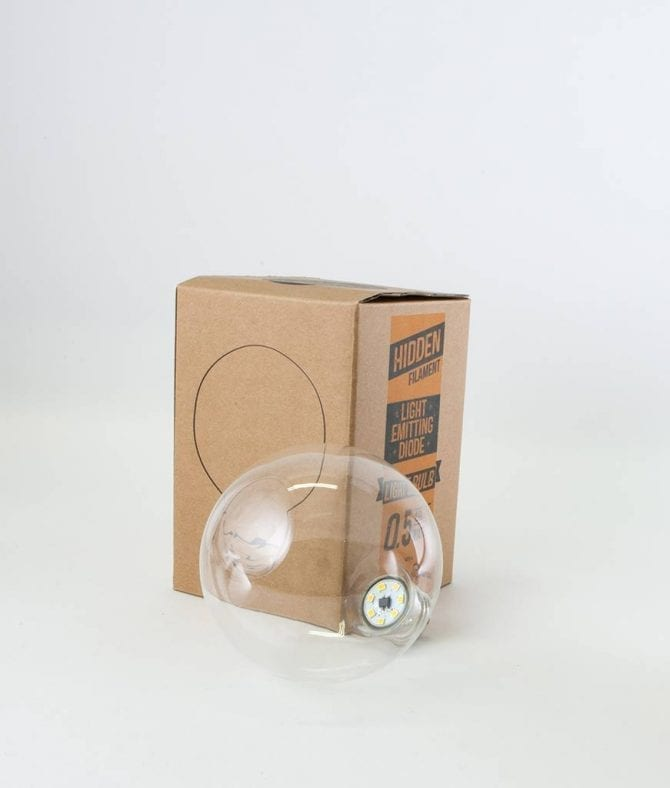 led bulb with concelaed filament with box against white background