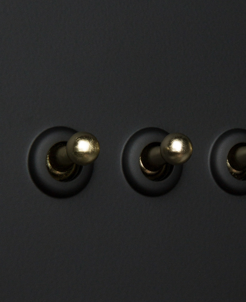 black and gold 4g dimmer switch close up