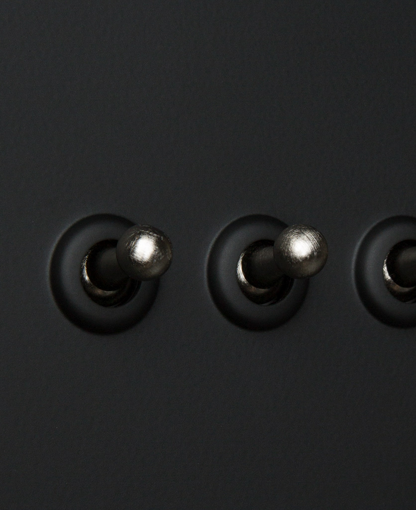 black and silver 4g dimmer switch close up