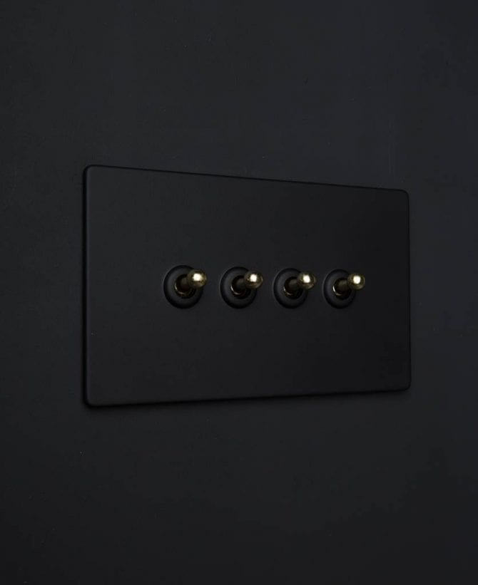black quadruple toggle switch with gold toggles