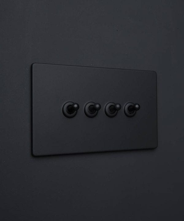 black quadruple toggle switch