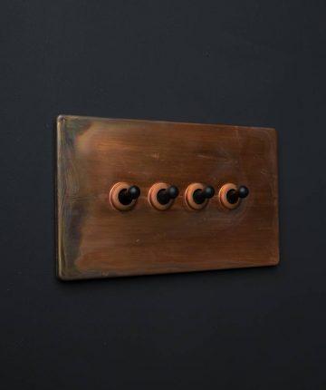 copper & black quadruple toggle switch