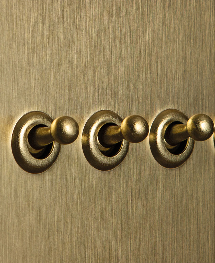 gold triple toggle switch with gold toggle detail