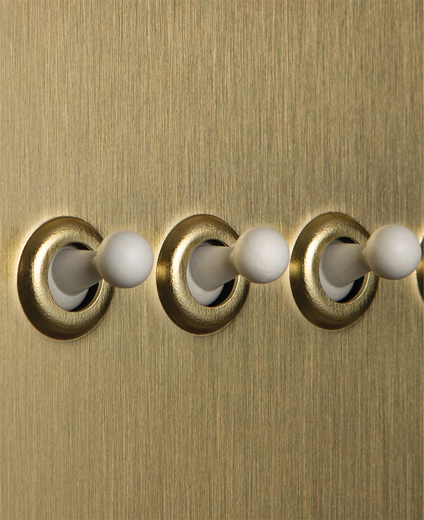 gold quadruple toggle switch with white toggle detail