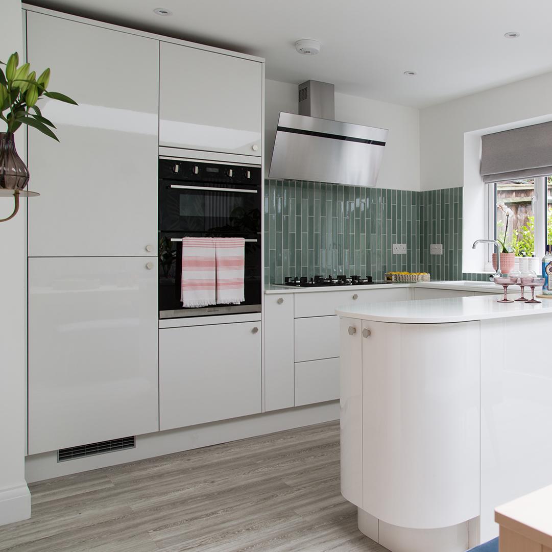 silver bauhaus hexagonal knobs on white kitchen drawers and doors