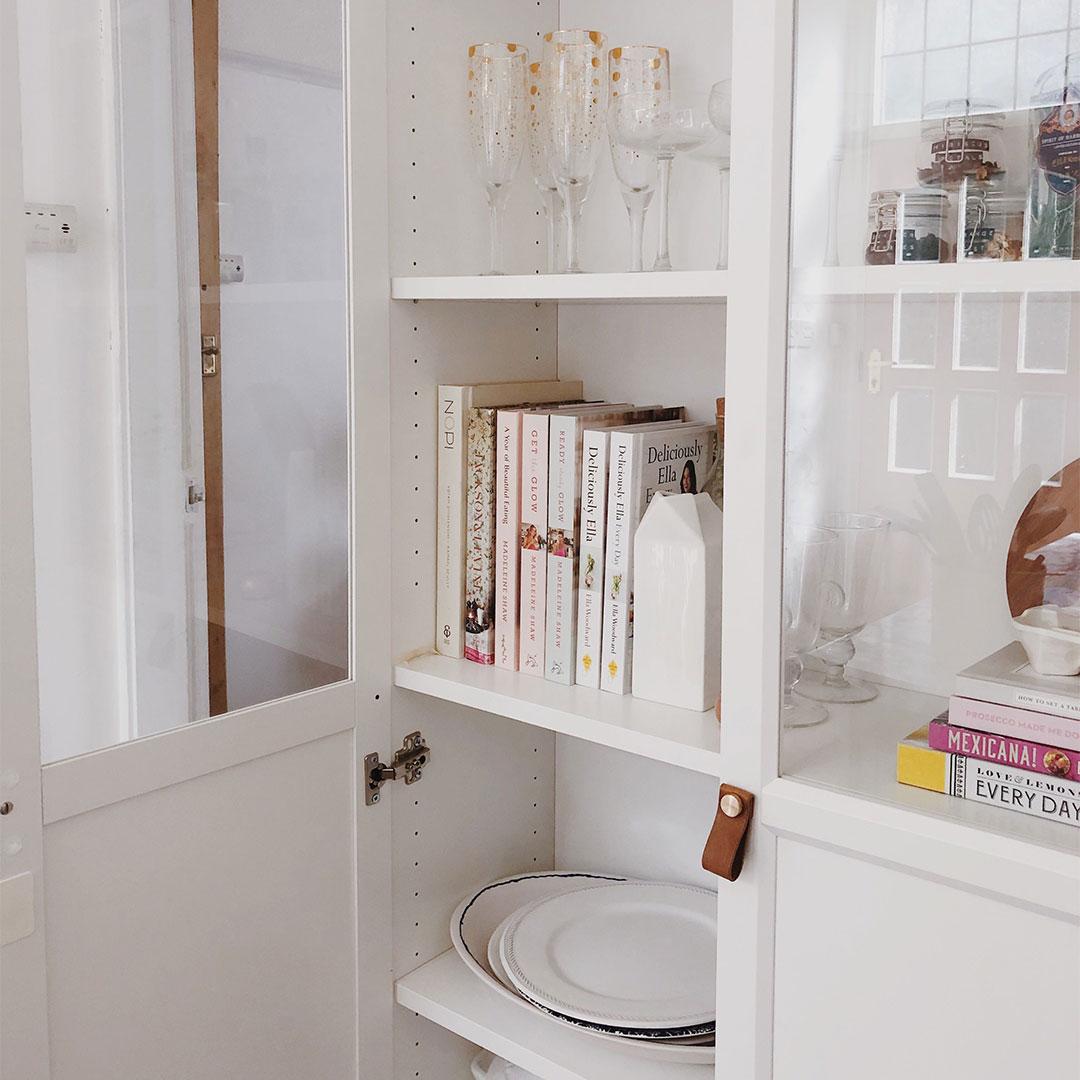 small magni dark tan handles on a white cabinet