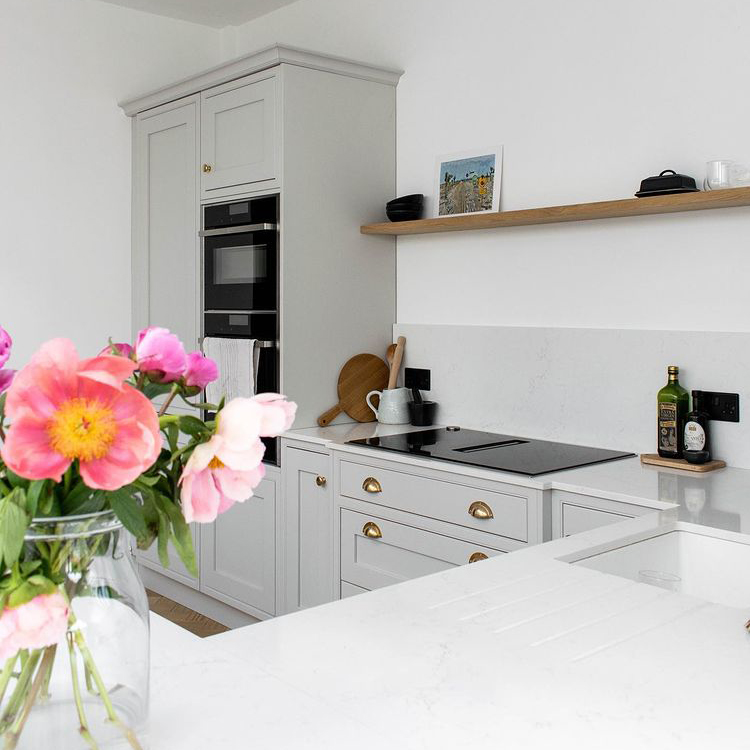 black switches and sockets in a soft grey and white kitchen