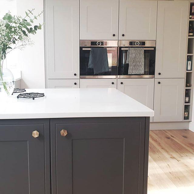 Bauhaus Hexagonal Knob on dark grey cupboard in a grey and white kitchen