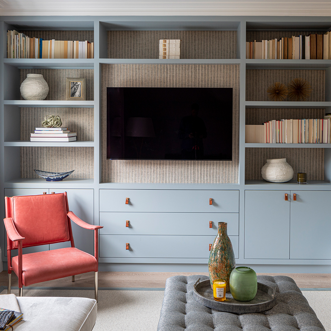 small magni dark tan handles on soft blue cupboards and drawers in a living room