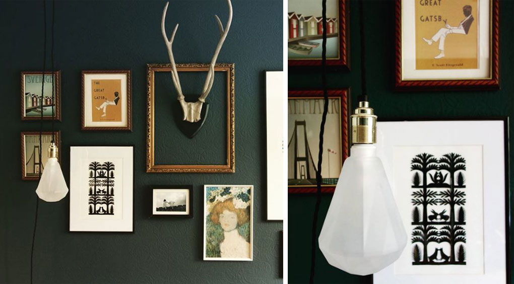 left image shows frosted diamond light bulb suspended from gold bilb holder and black twisted fabric cable against dark green painted gallery wall. right image shows closeup of the frosted diamond light bulb