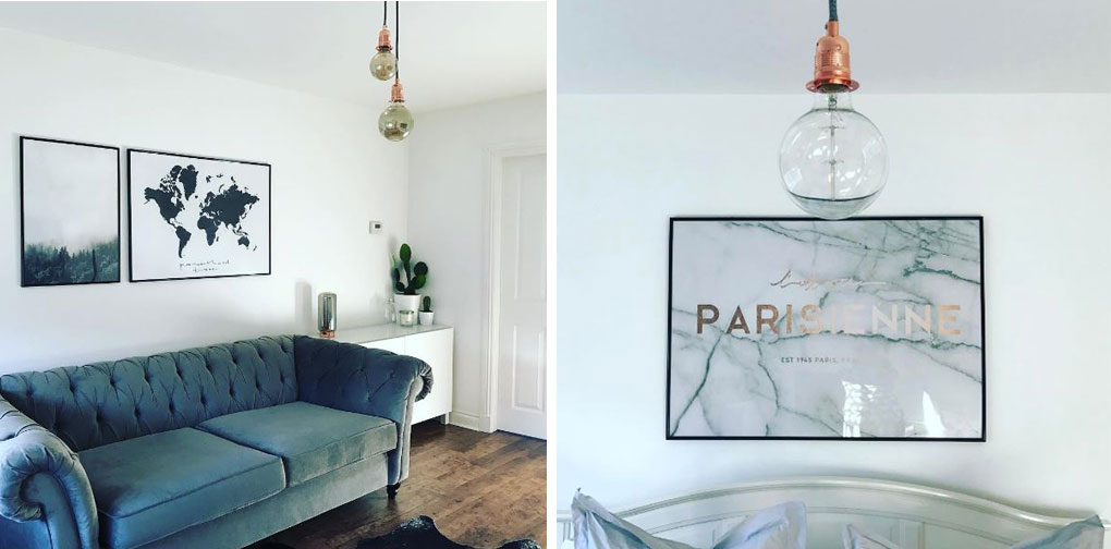 left image shows mirrored light bulbs suspended from copper bulb holders and black fabric cable in  white living room, with dark blue chesterfield sofa. right image shows closeup of mirrored bulbs in front of a marbled piece of artwork