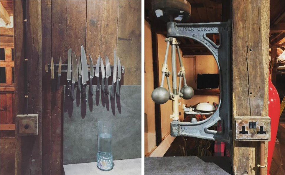 industrial rustic wood clad kitchen with smoked gold dimmer switch and metal knife block