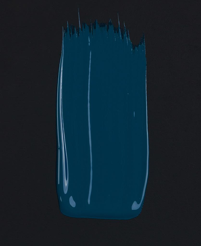 In deep water rich blue paint swatch on dark background