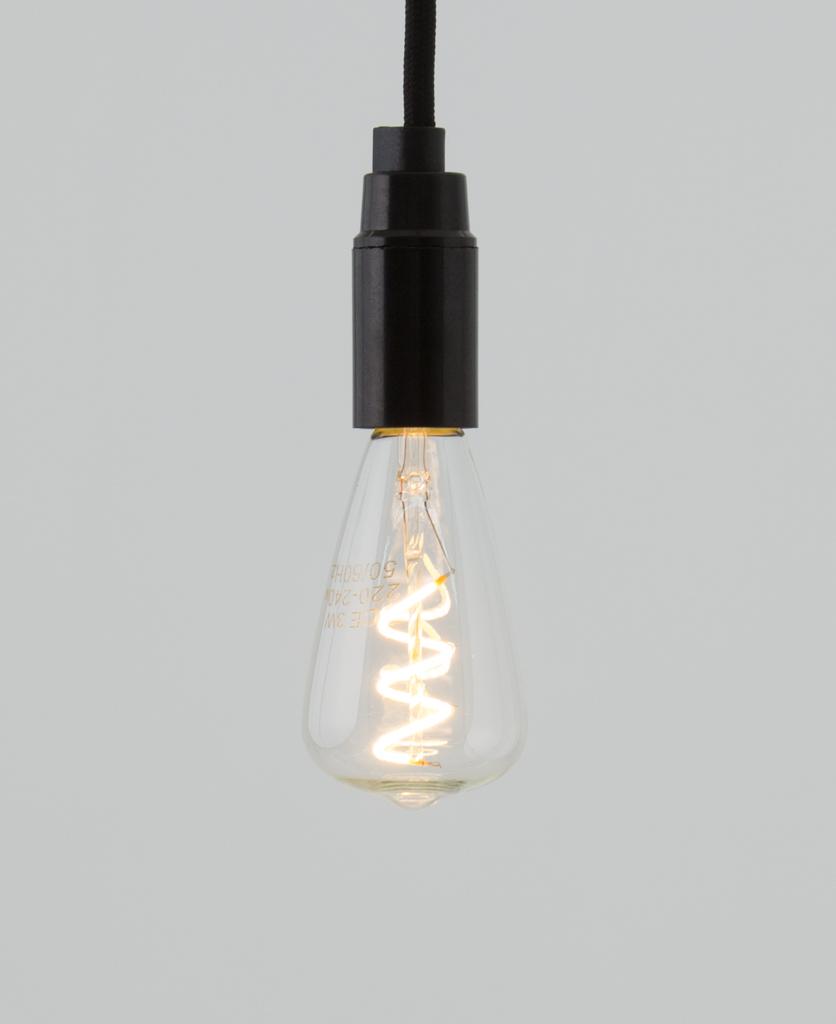 pear spiral filament LED light bulb e14 against white background
