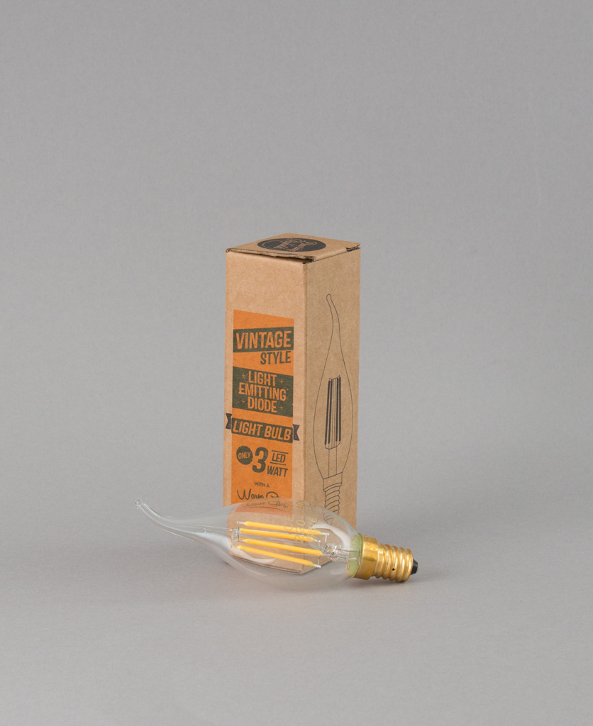 E14 LED candle bulbs with squirrel cage filament against grey background with box