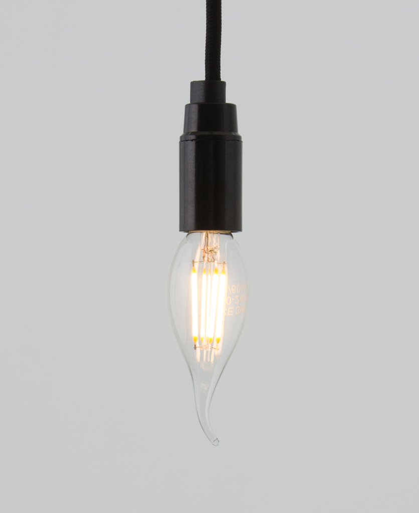 E14 LED candle bulbs with squirrel cage filament against white background