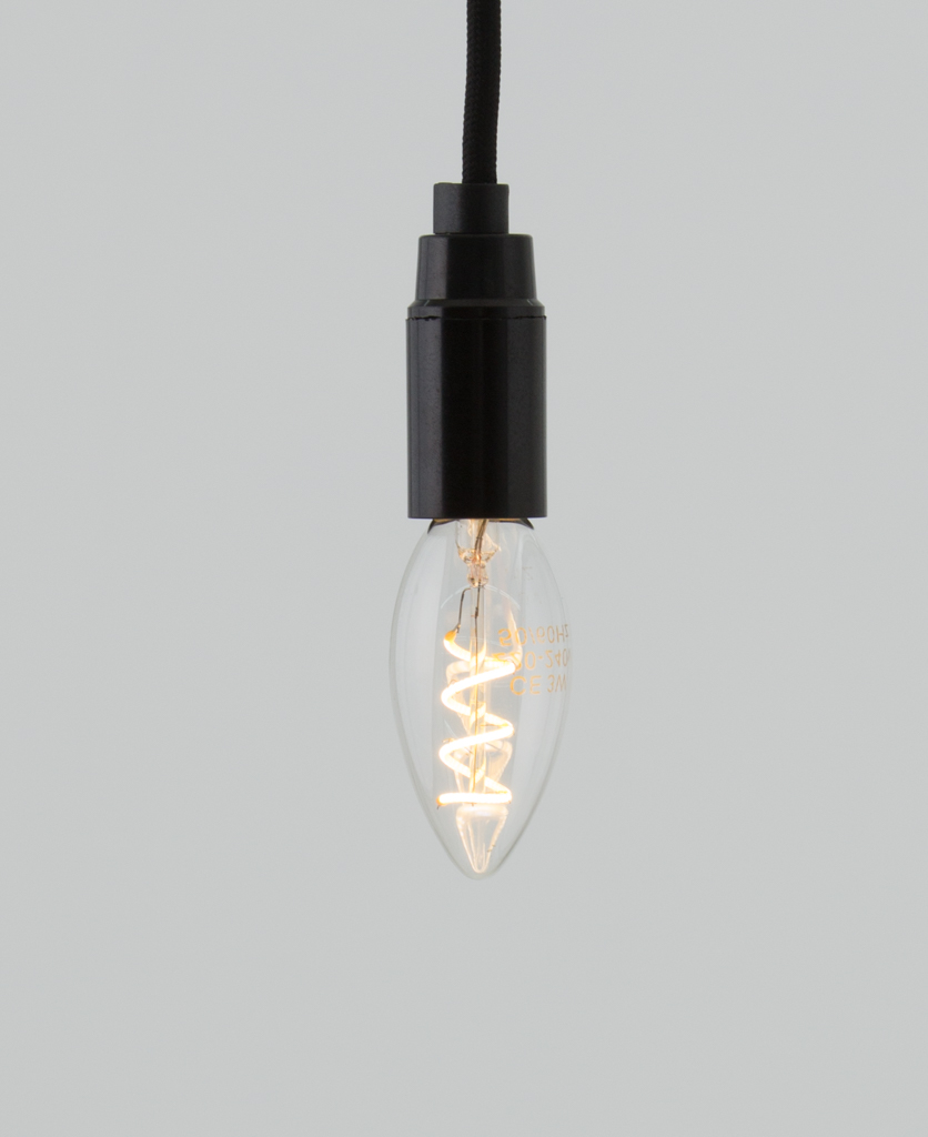 E14 LED candle bulbs with spiral filament against white background