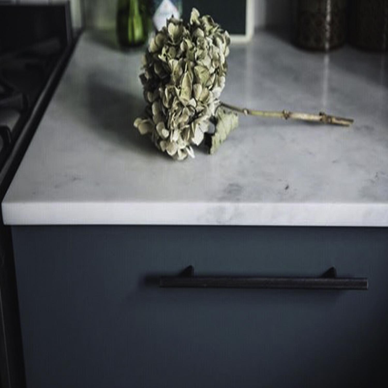 black skyscraper knurled handle on navy drawer