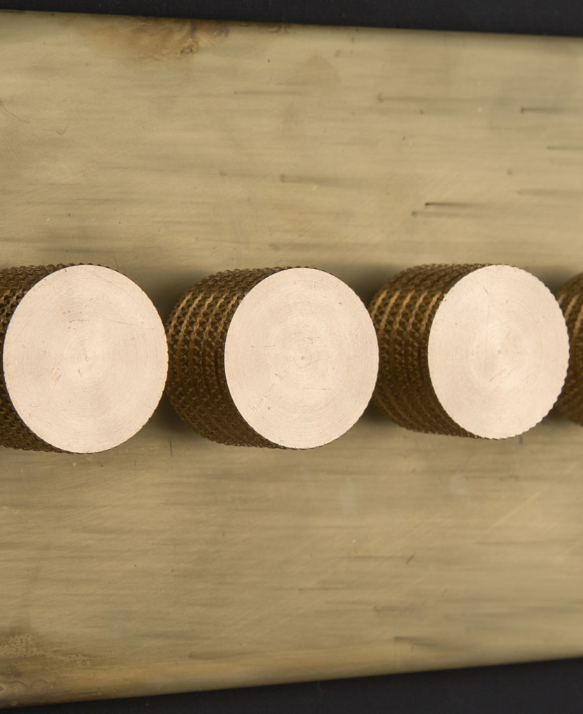 smoked gold quadruple dimmer switch with gold knobs