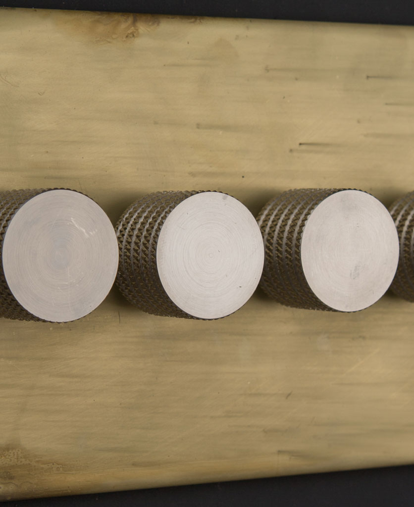 smoked gold quadruple dimmer switch with silver knobs