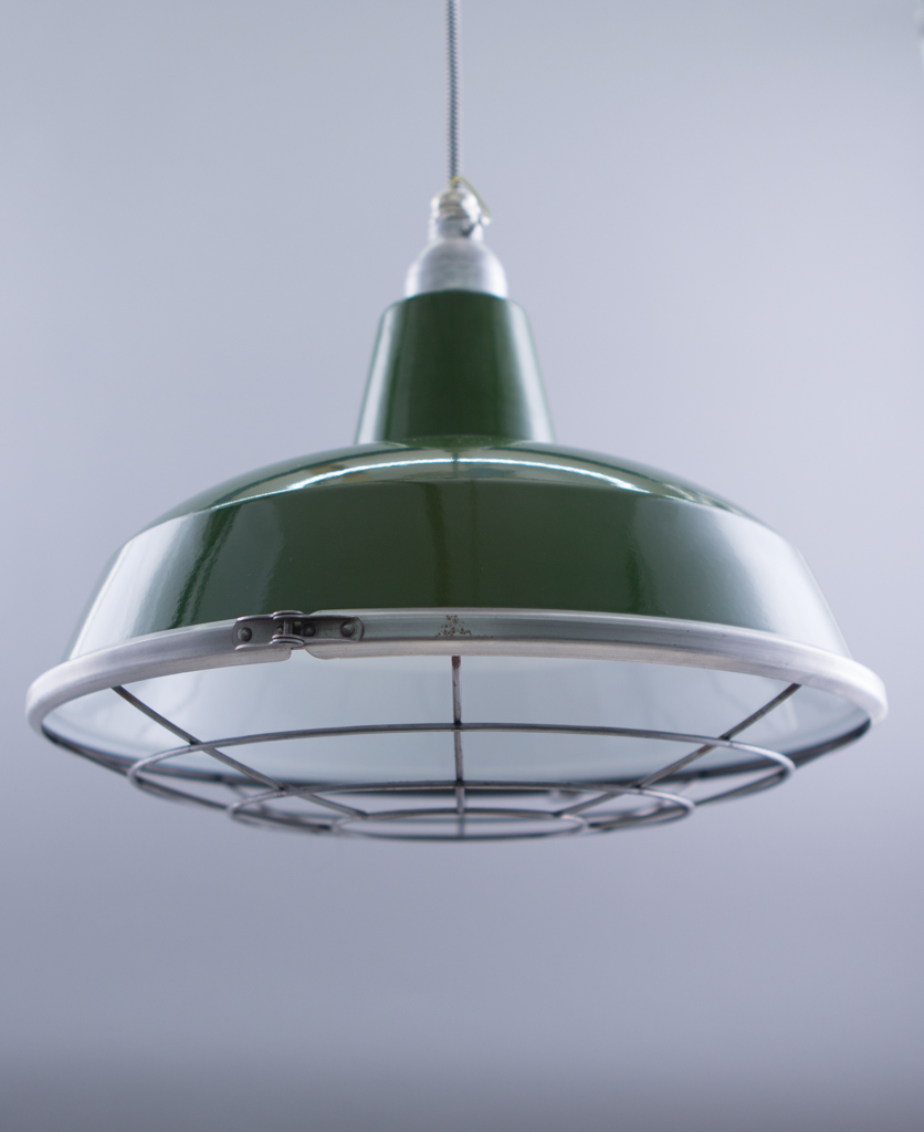 green enamel cage light shades against grey background
