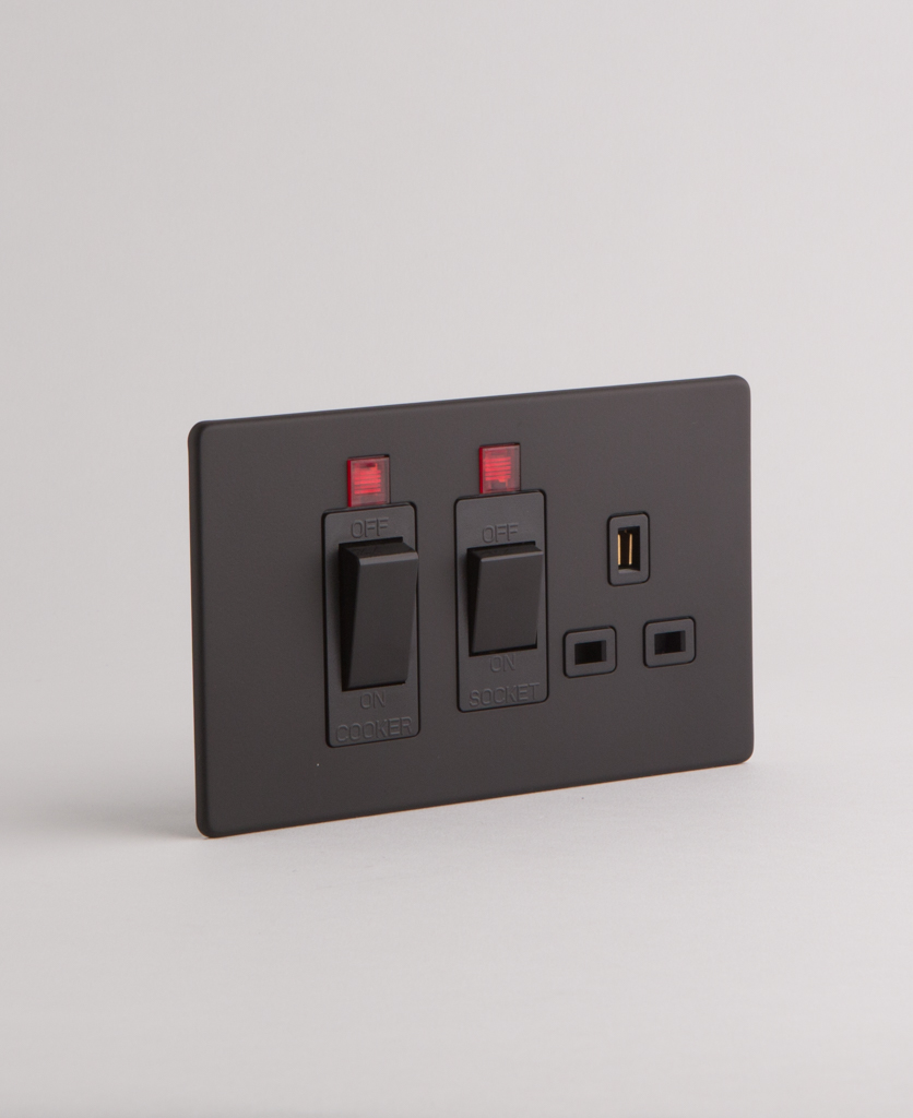 black cooker switch against white background