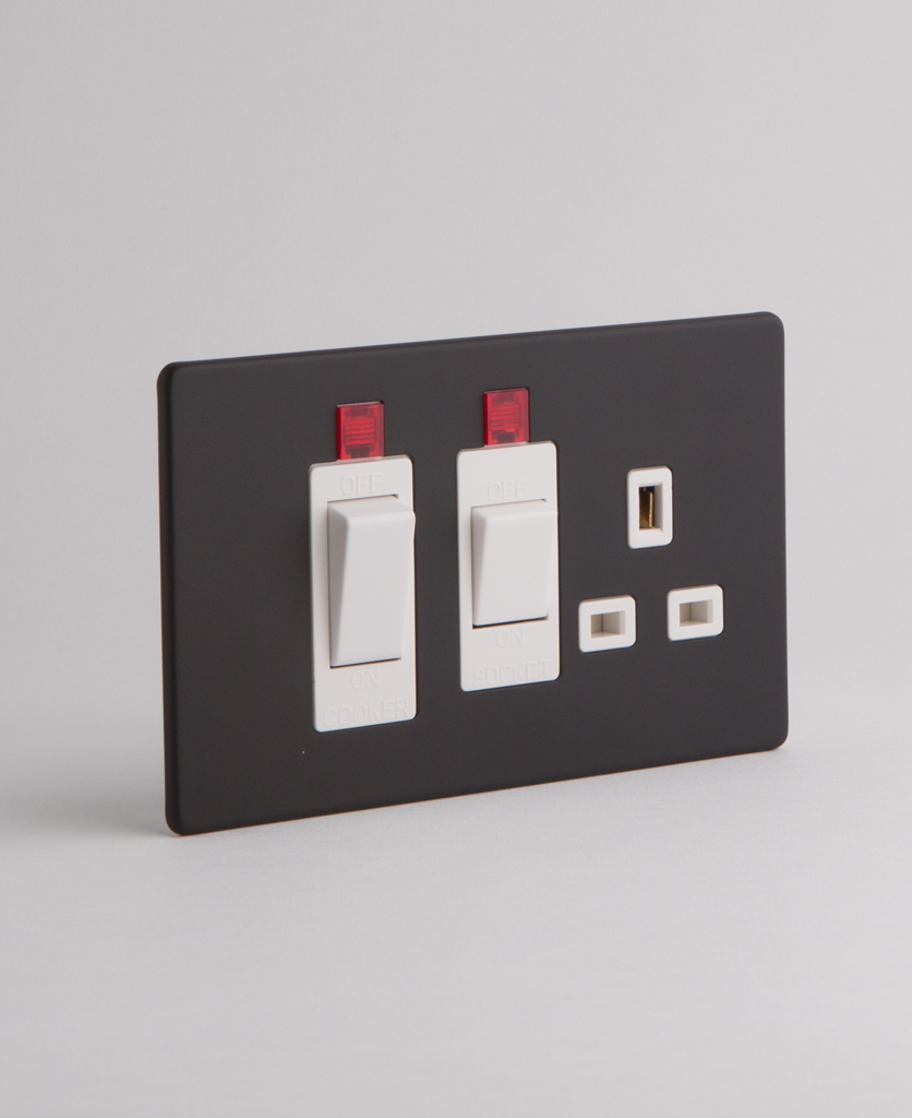 black and white cooker switch against white background