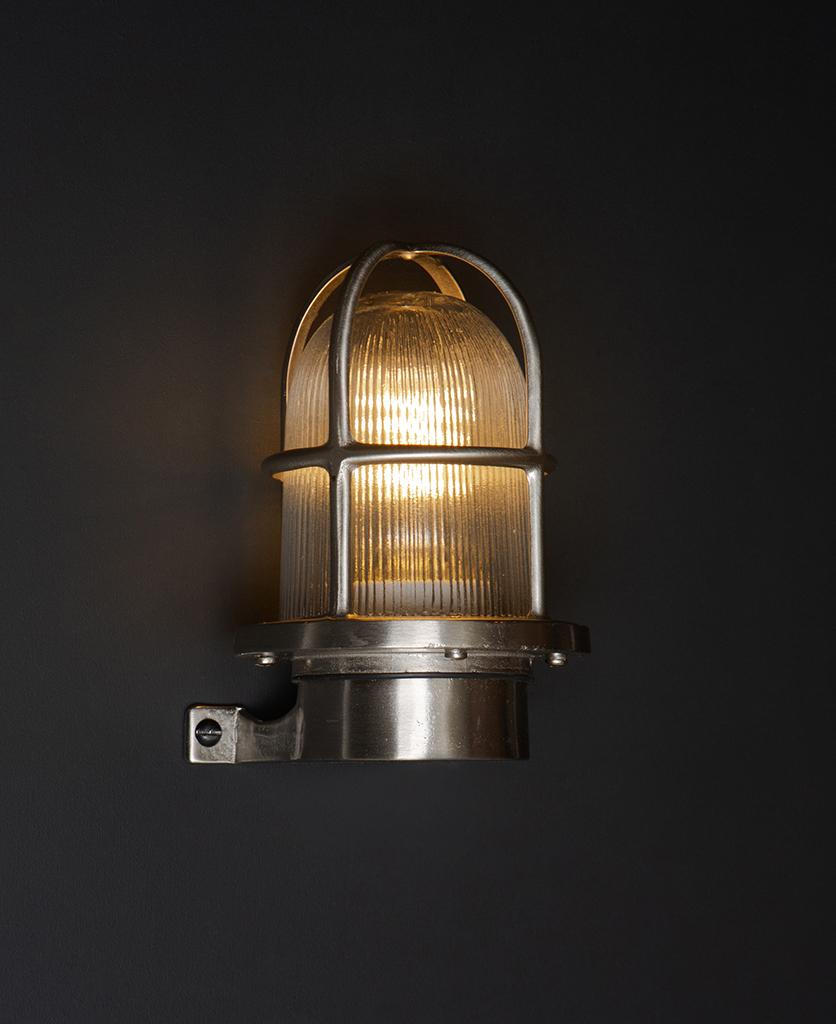 simon silver bulkhead light on black wall