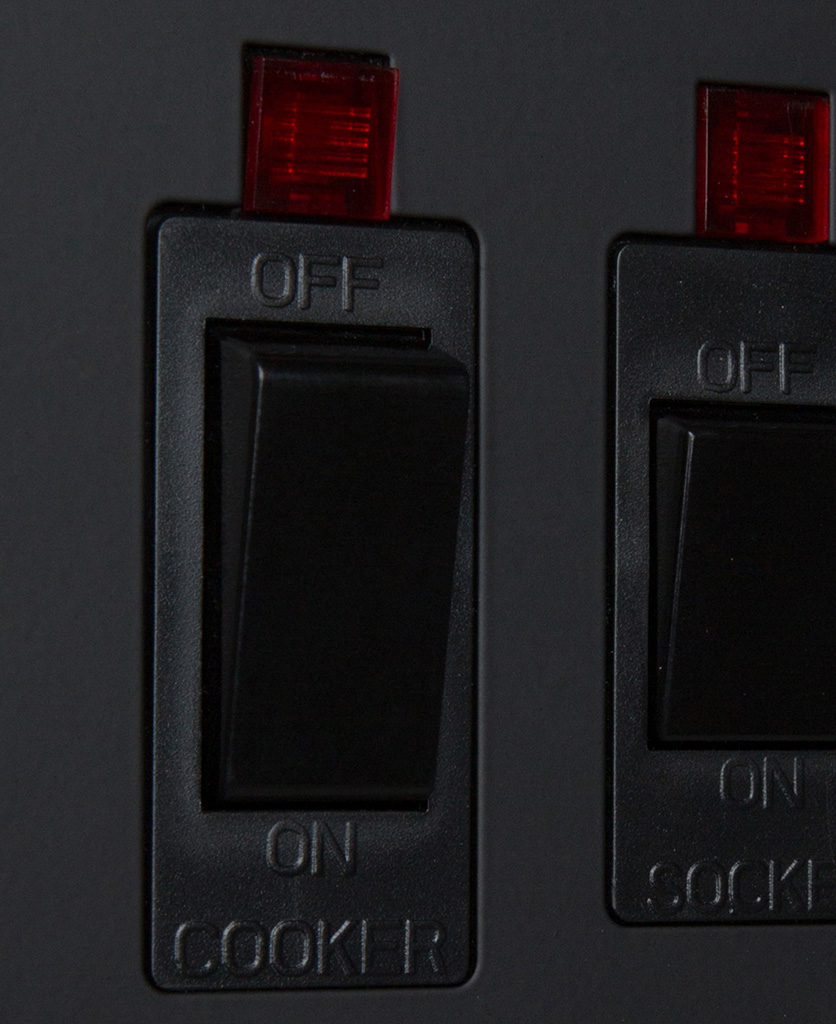 black cooker switch and socket close up