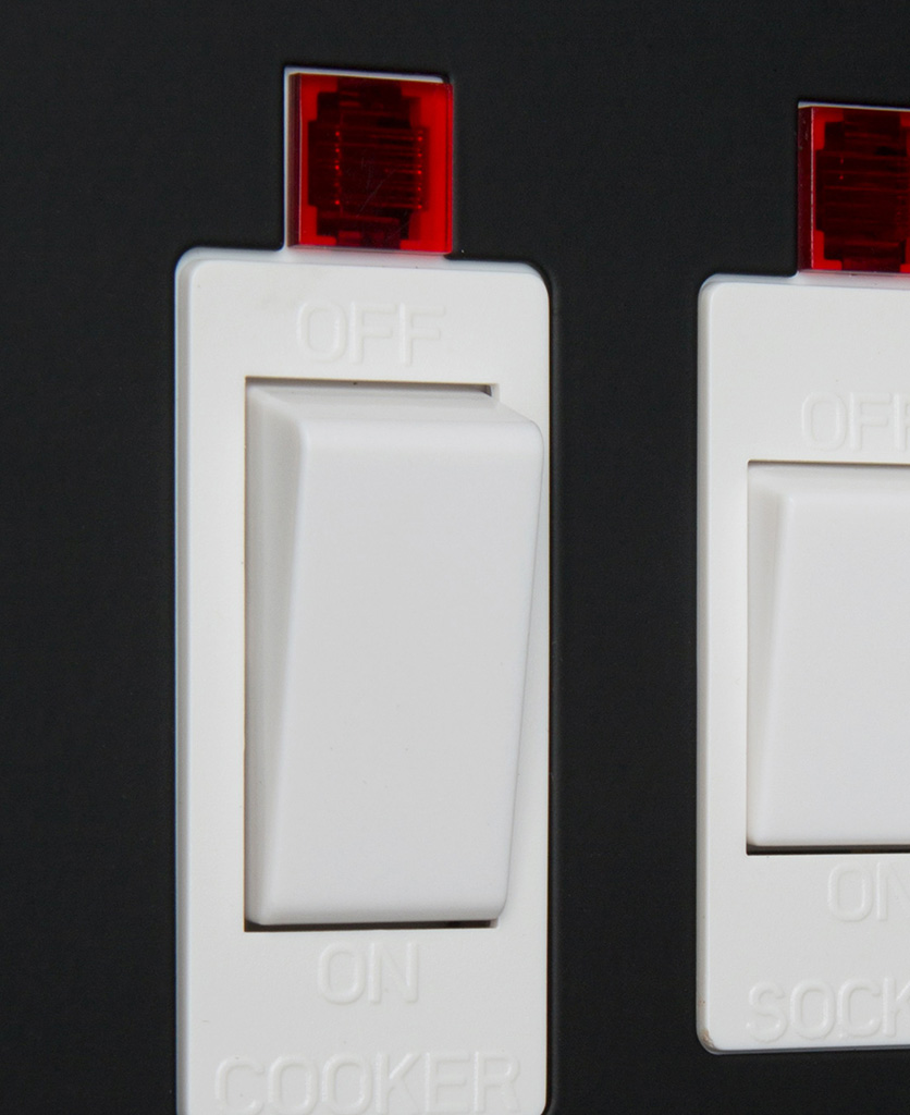 black and white cooker switch and socket close up