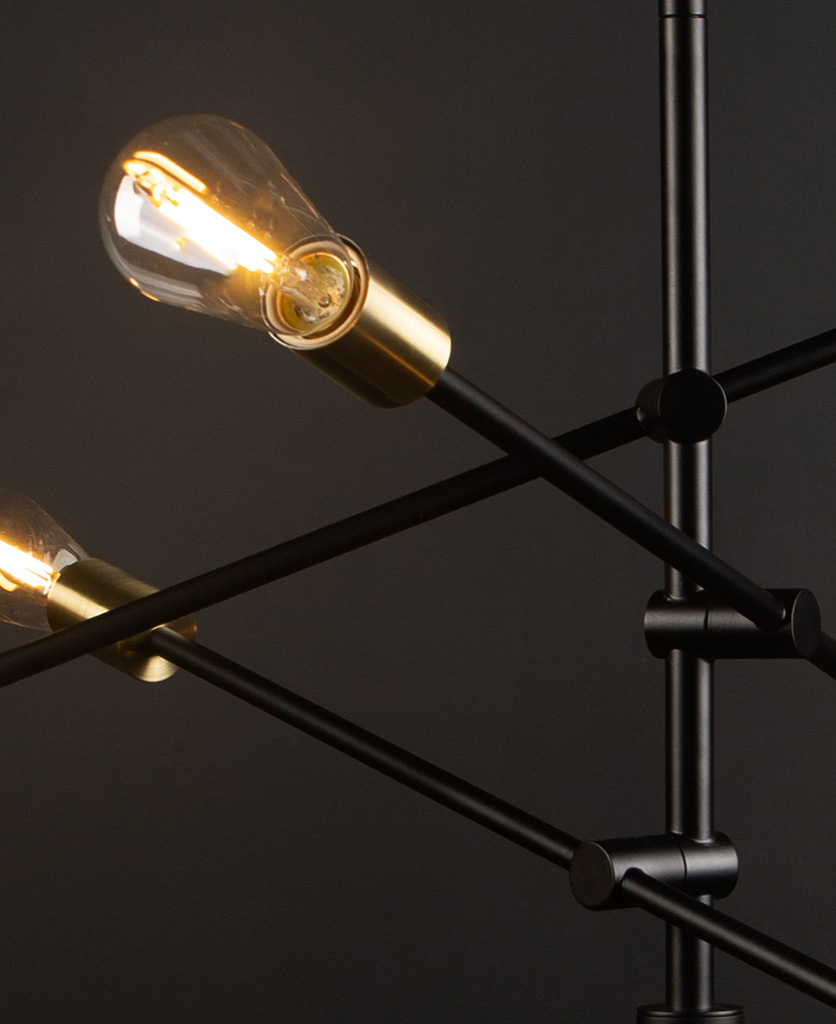black modern chandelier with clear pear bulbs close up against black background