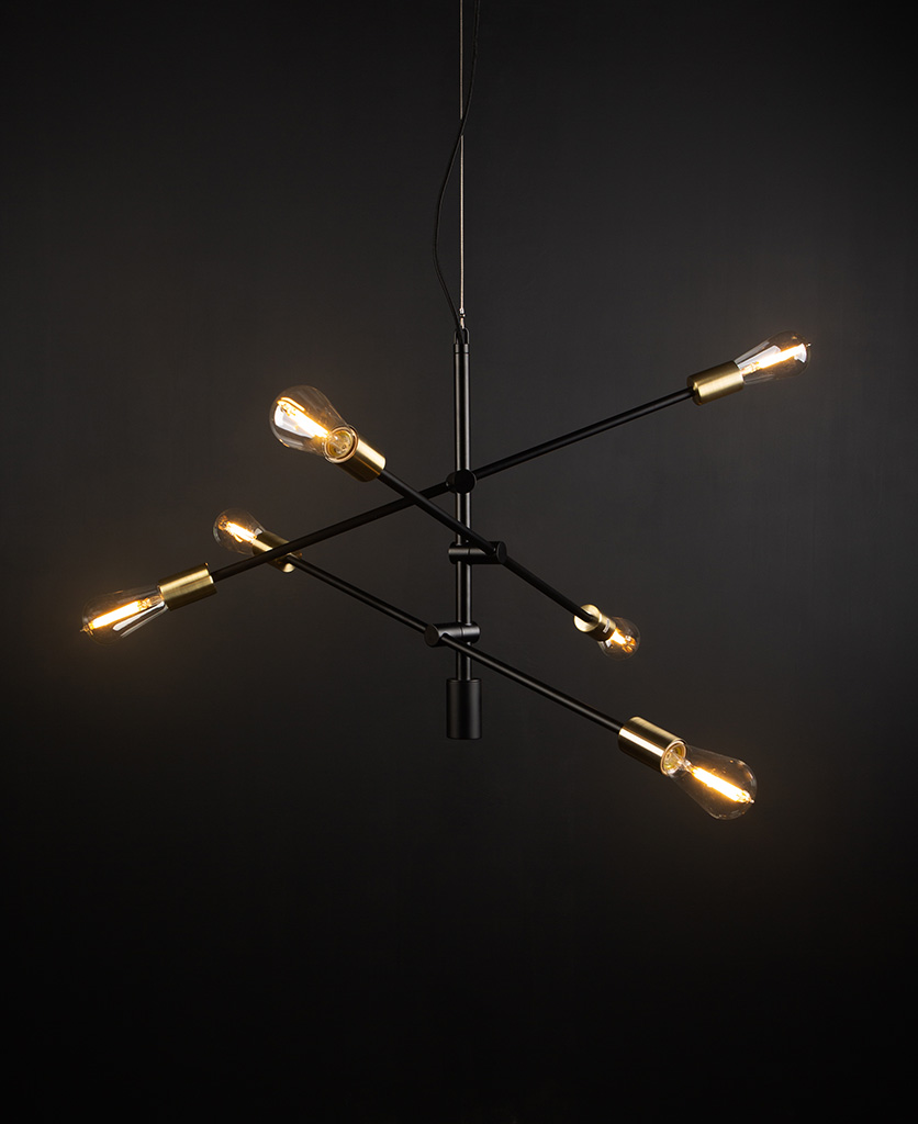 black modern chandelier with clear pear bulbs against black background