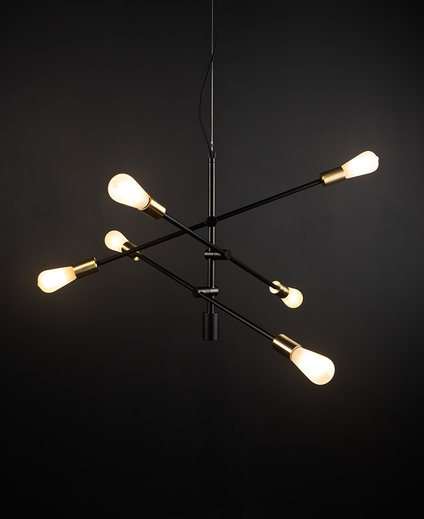 black modern chandelier with frosted pear bulbs against black background