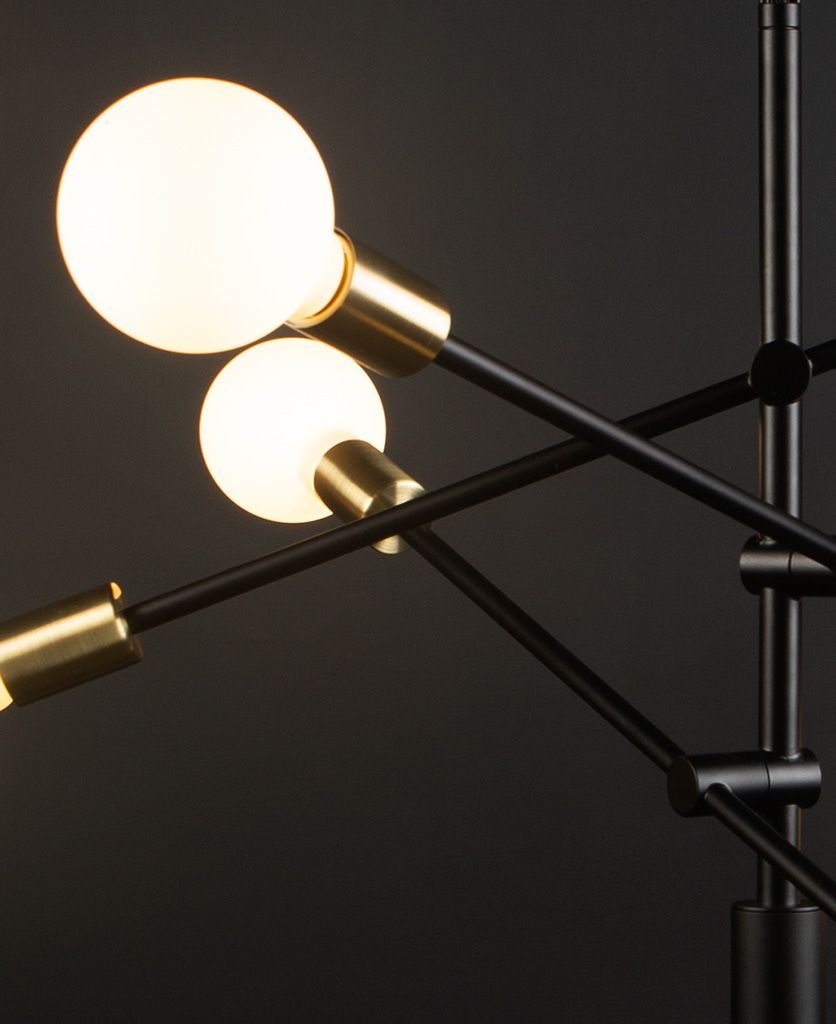 black modern chandelier with opal bulbs close up against black background