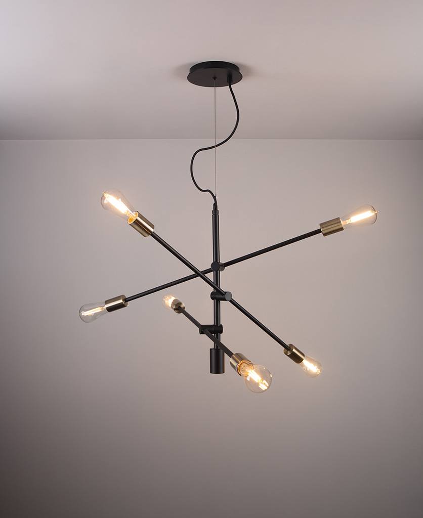 black modern chandelier with clear pear bulbs on a grey background