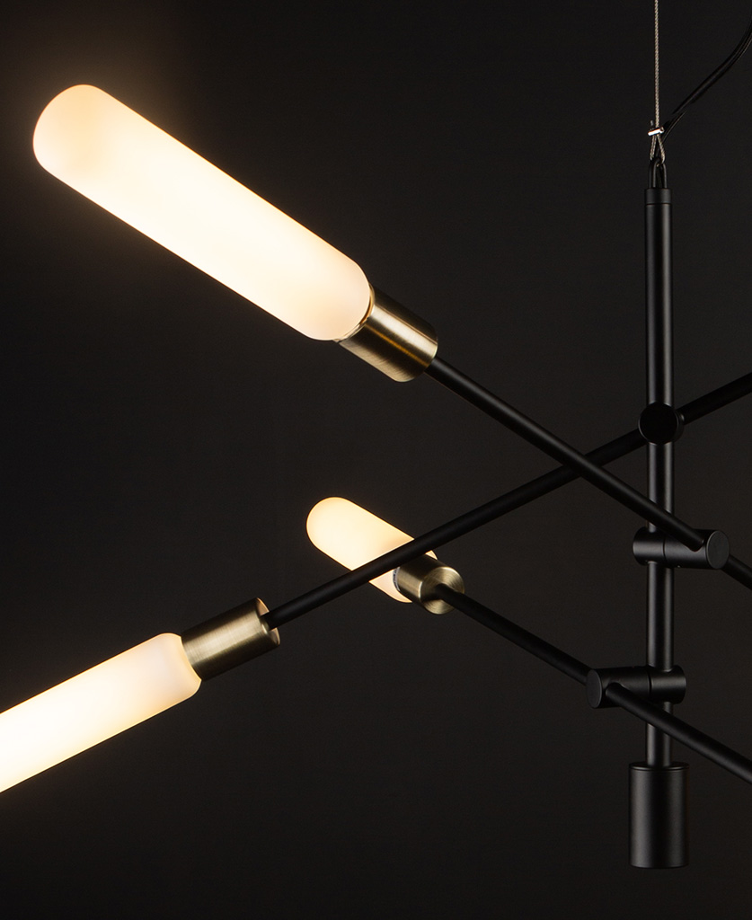 close up of black modern chandelier with luna opal bulbs on black background