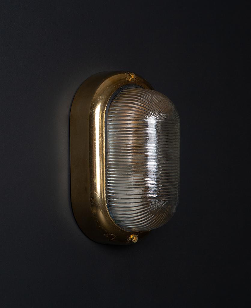 unlit brass mike led external light on black background