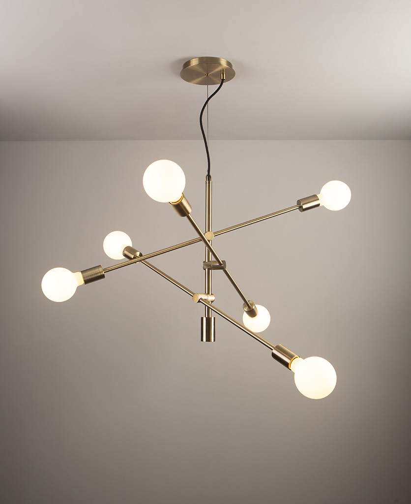 brass feature pendant lights on grey ceiling and wall