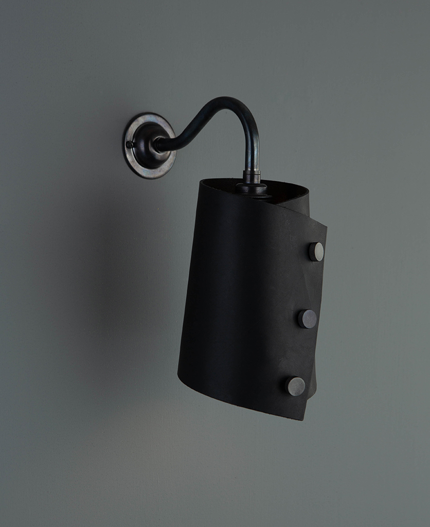 antique black wall sconce lighting with black leather light shade on grey wall