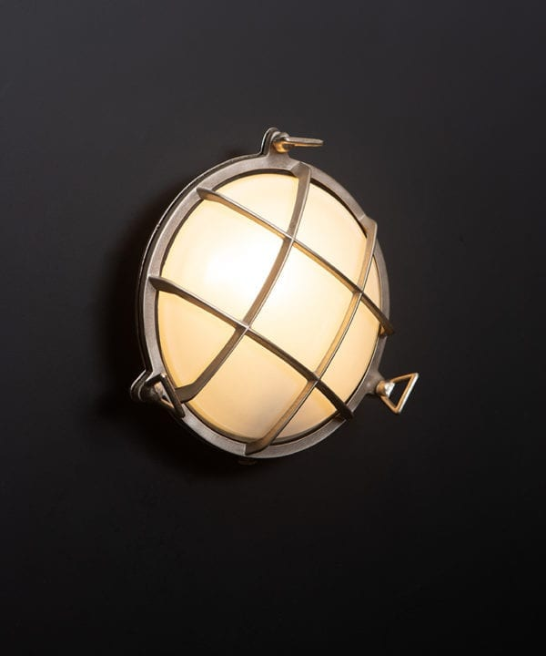 chris silver Bulkhead LED Light with lit bulb on black wall
