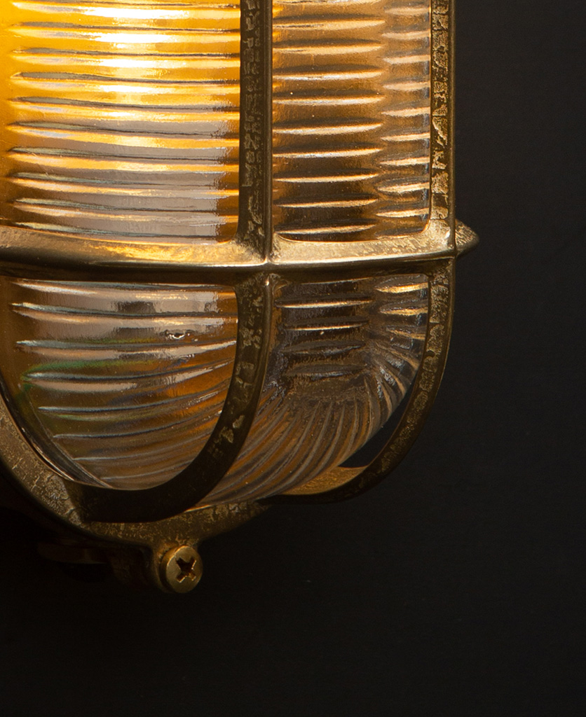 dave gold bulkhead wall light close up with bulb