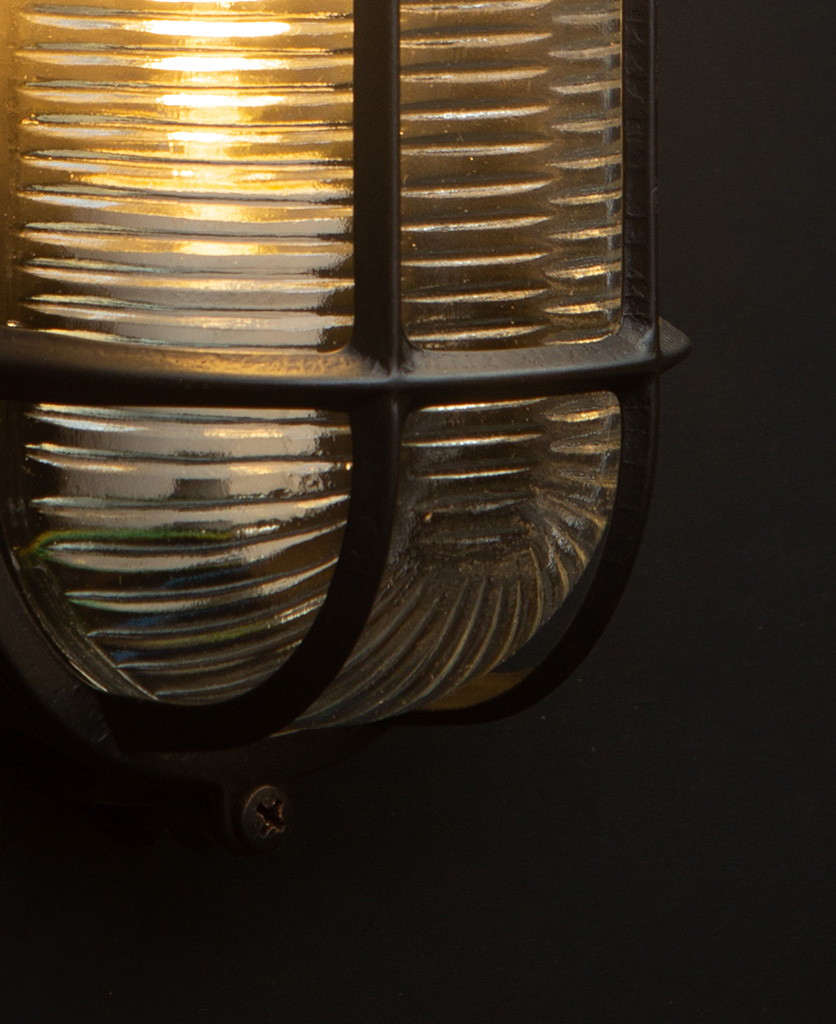 dave pewter bulkhead wall light close up with bulb