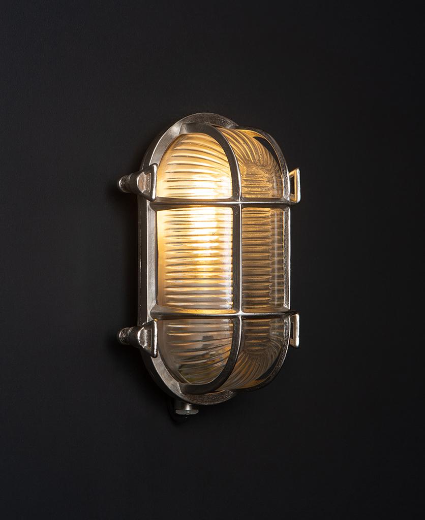 steve silver bulkhead outdoor lights with lit bulb against black background